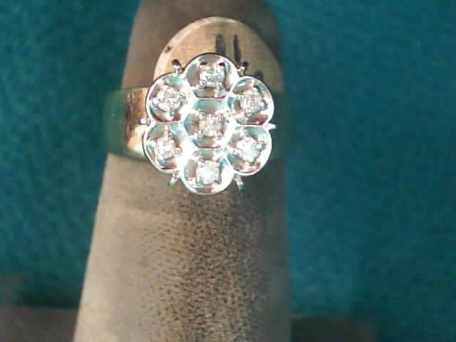 Lady's Diamond Fashion Ring 7 Diamonds .07 Carat T.W. 10K Yellow Gold 2.3dwt