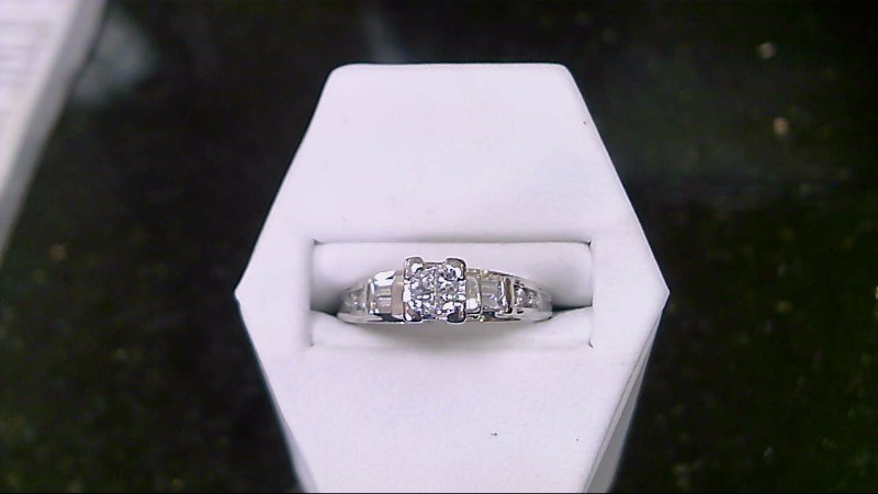 14kwg princess cut illusion with 6-1mm rds and 4 bagg ring