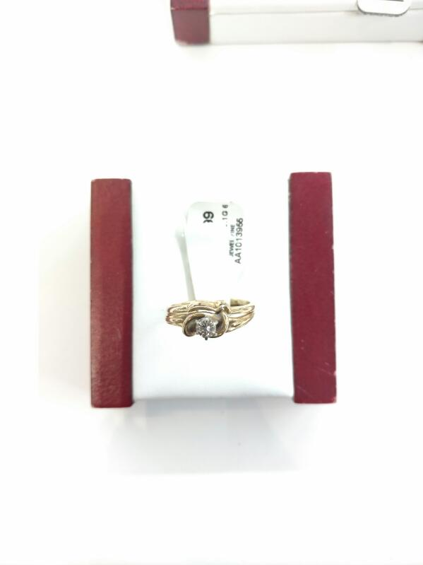 Lady's Diamond Fashion Ring .15 CT. 14K Yellow Gold 3.1g Size:6