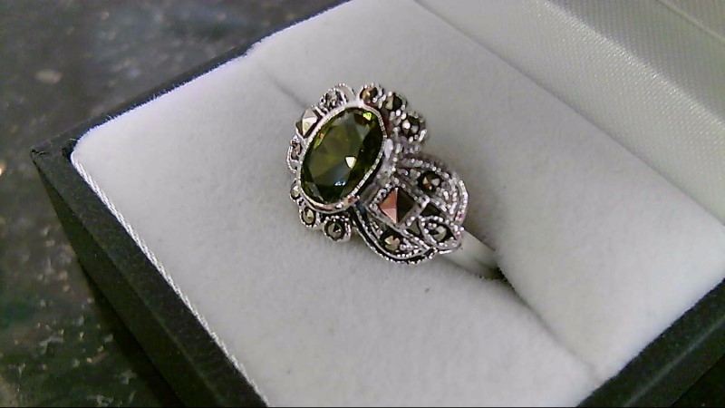 Lady's sterling silver 925 peridot and maracite ring