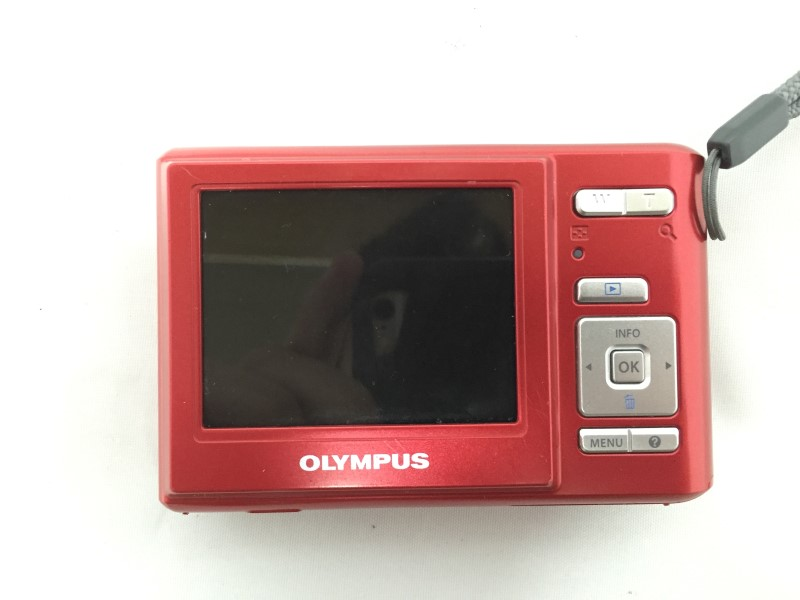 OLYMPUS RED DIGITAL CAMERA, MODEL# T-100, 12 MP, RED, WITH CASE AND CHARGER.