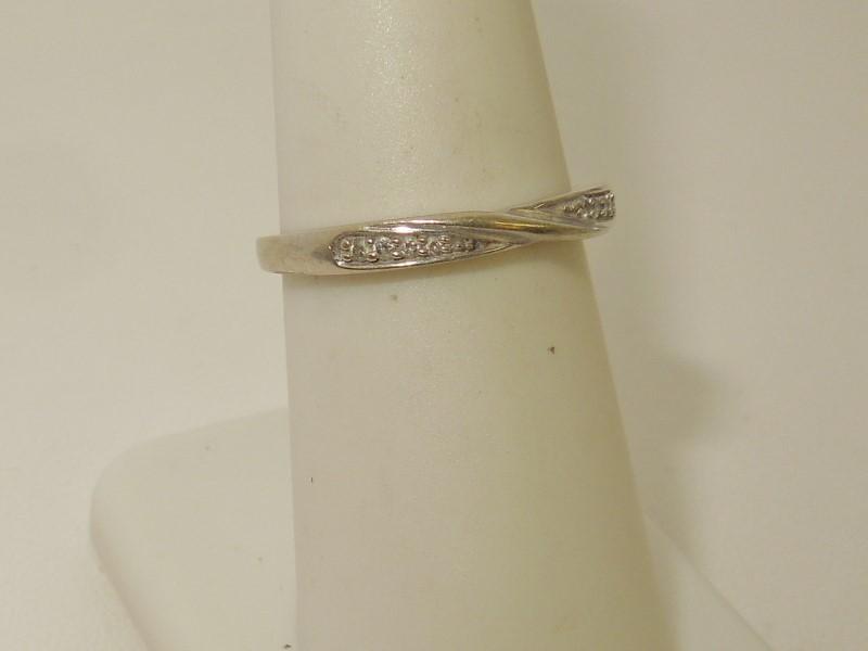 Lady's Diamond Wedding Band 8 Diamonds .08 Carat T.W. 10K White Gold 1.7g