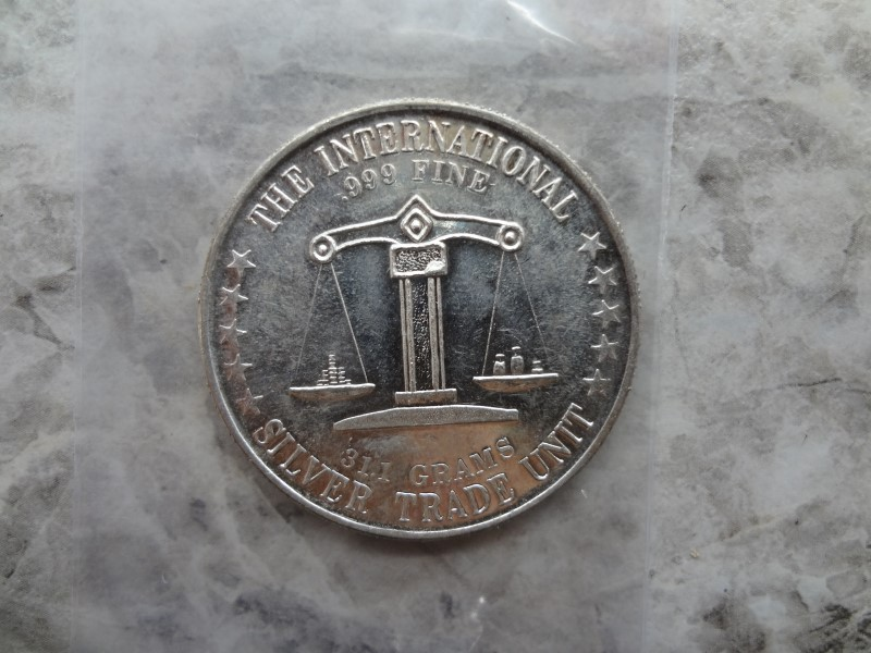 THE INTERNATIONAL SILVER TRADE UNIT AMERICA 1 TROY OUNCE