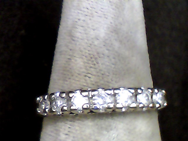 Lady's Diamond Wedding Band 7 Diamonds .35 Carat T.W. 10K Yellow Gold 1.4dwt