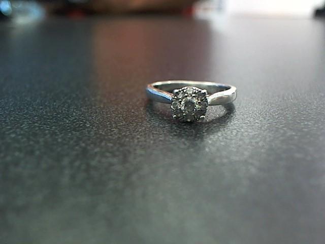 Lady's Silver-Diamond Ring 9 Diamonds .17 Carat T.W. 925 Silver 2g