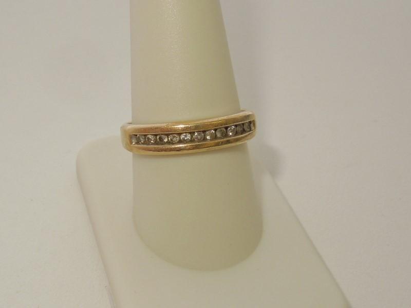 Lady's Diamond Wedding Band 11 Diamonds .11 Carat T.W. 10K Yellow Gold 3.3g