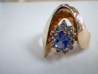 Synthetic Tanzanite Lady's Stone & Diamond Ring 11 Diamonds .33 Carat T.W.