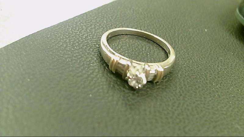 Lady's Diamond Solitaire Ring 7 Diamonds .24 Carat T.W. 14K 2 Tone Gold 3.8g