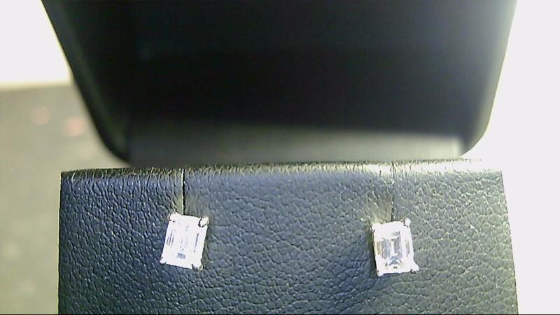 lady's 14k white gold apx. (.36cttw) emerald cut diamond stud earrings