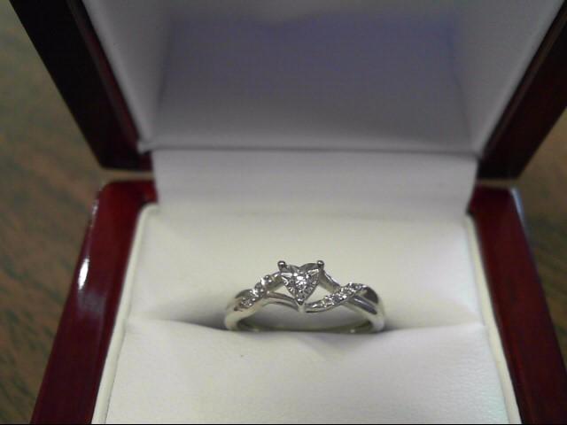 Lady's Silver-Diamond Ring 7 Diamonds .09 Carat T.W. 925 Silver 1.1dwt