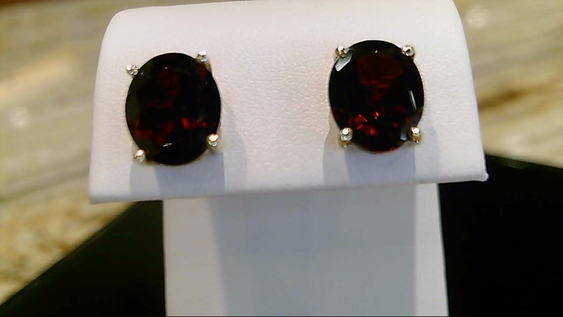 Lady's 10k yellow gold oval garnet earrings