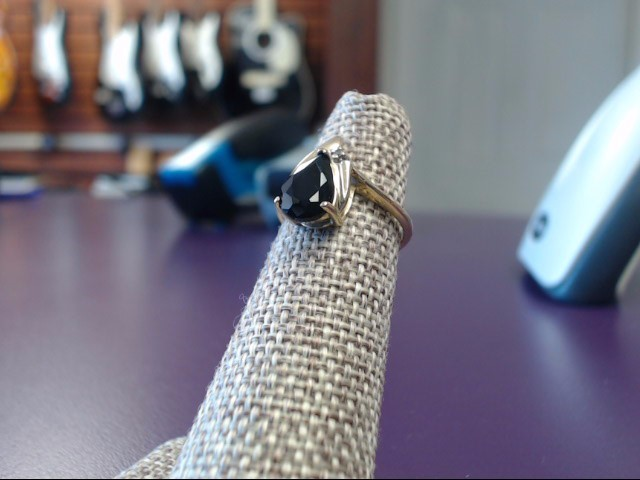 Black Stone Lady's Stone & Diamond Ring .01 CT. 10K Yellow Gold 2.09g Size:4