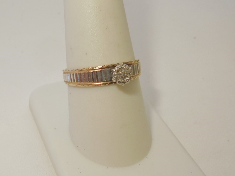 Lady's Diamond Solitaire Ring 7 Diamonds .035 Carat T.W. 10K 2 Tone Gold 2.5g
