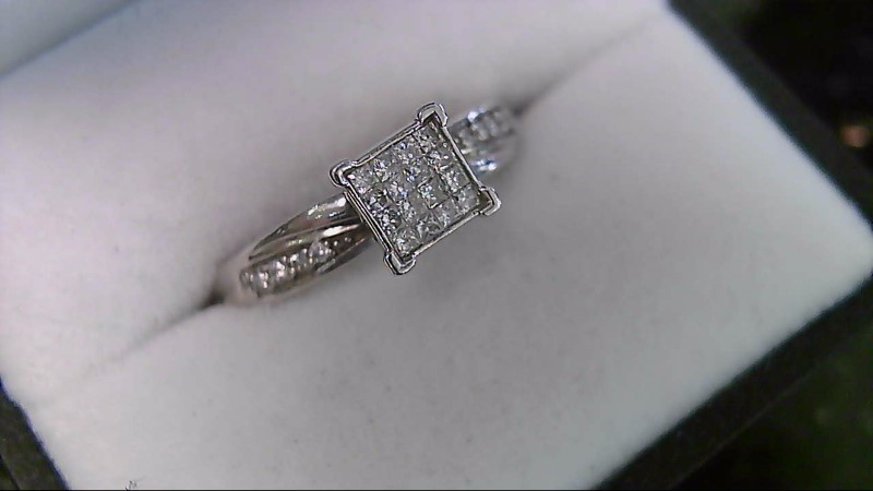 lady's 10k wht gold appx. 1/4cttw princess cut and round illusion ring
