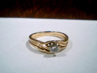 Lady's Diamond Wedding Set .20 CT. 14K Yellow Gold 3.3g Size:6.8
