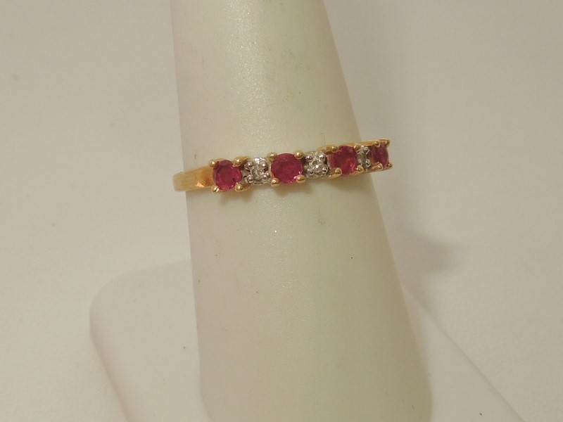 Synthetic Ruby Lady's Stone & Diamond Ring 4 Diamonds .020 Carat T.W.