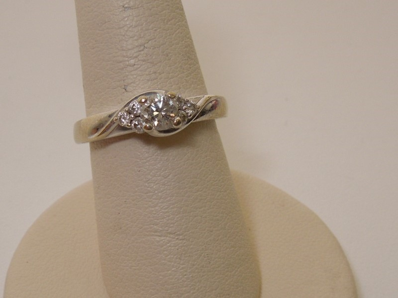 Lady's Diamond Solitaire Ring 7 Diamonds .49 Carat T.W. 14K White Gold 3.9g