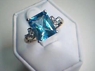 Synthetic Blue Topaz Lady's Stone & Diamond Ring 6 Diamonds .18 Carat T.W.