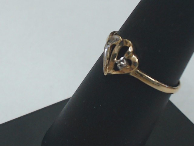 Lady's Diamond Engagement Ring .01 CT. 10K Yellow Gold 1.2g Size:6.8