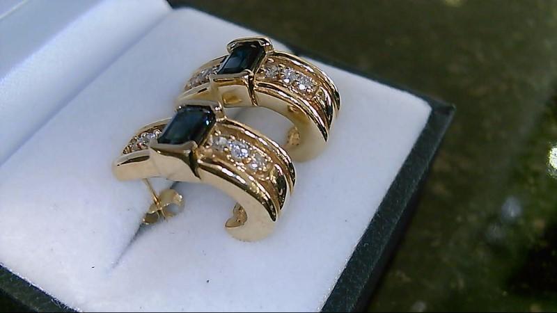 Lady's 14k yellow gold emerald cut blue sapphire wiht 12-2mm round diamonds