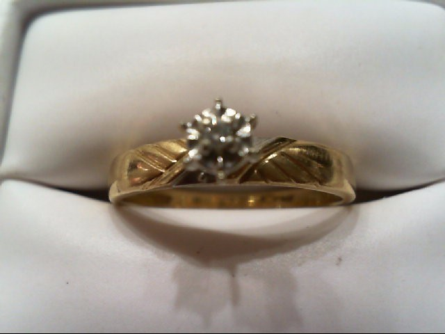 Lady's Diamond Engagement Ring .02 CT. 10K Yellow Gold 1.8g