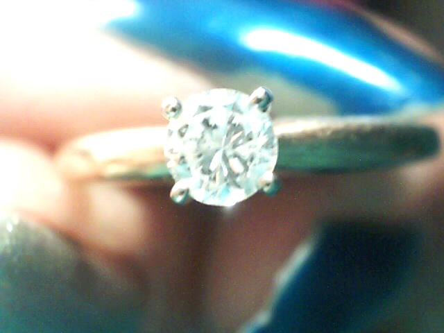 Lady's Diamond Solitaire Ring .17 CT. 10K Yellow Gold 1.1dwt