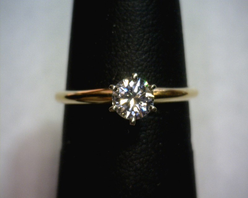 Lady's Diamond Solitaire Ring .64 CT. 14K Yellow Gold 1.2dwt Size:5.2