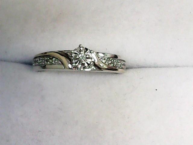 Lady's Diamond Solitaire Ring 5 Diamonds .06 Carat T.W. 10K 2 Tone Gold 2.6dwt