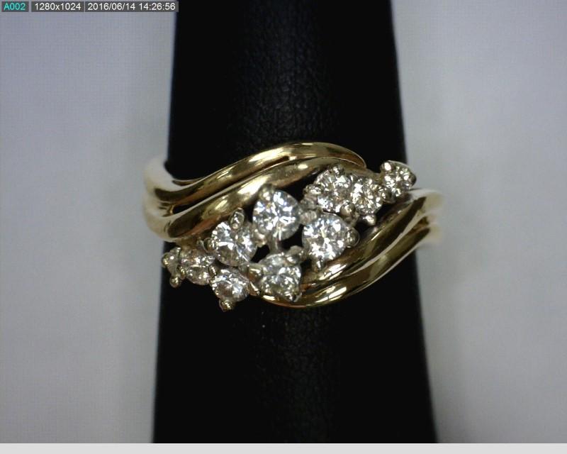 Lady's Diamond Cluster Ring 10 Diamonds .31 Carat T.W. 14K Yellow Gold 3.34dwt