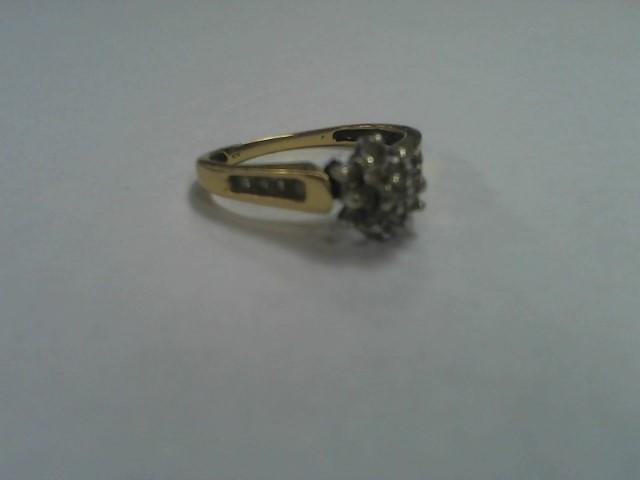 Lady's Diamond Cluster Ring 12 Diamonds .12 Carat T.W. 14K Yellow Gold 2.2g