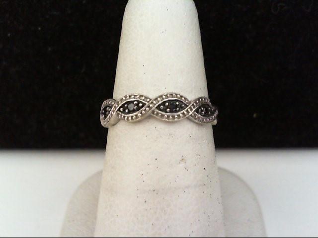 Lady's Diamond Fashion Ring 4 Diamonds .04 Carat T.W. 10K White Gold 1.7g