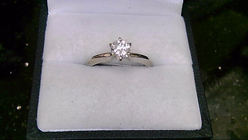 Lady's 14k wht gold .51ct rd (H-I3) dia sol ring, 2.91g