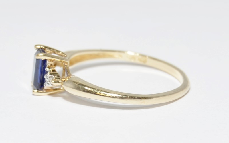 Synthetic Sapphire Lady's Stone & Diamond Ring 2 Diamonds .02 Carat T.W.
