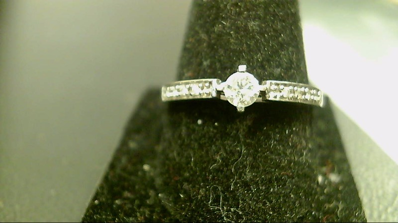 Lady's Diamond Fashion Ring 9 Diamonds .36 Carat T.W. 10K White Gold 1.8g