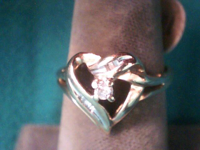 Lady's Diamond Fashion Ring 10 Diamonds .095 Carat T.W. 10K Yellow Gold 1.9dwt