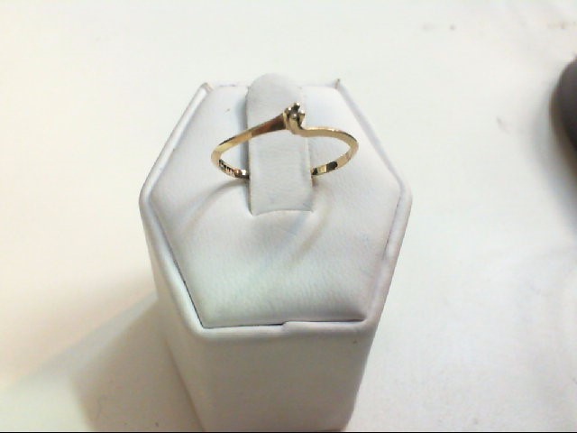 Lady's Diamond Solitaire Ring .01 CT. 10K Yellow Gold 0.7g