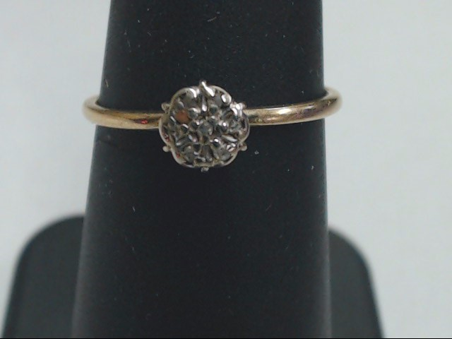 Lady's Diamond Cluster Ring 7 Diamonds .035 Carat T.W. 10K Yellow Gold 1g