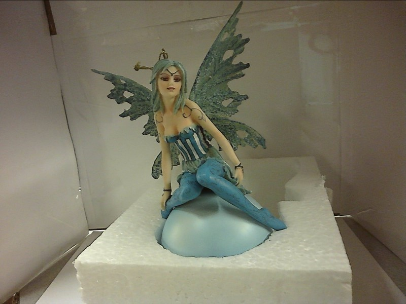 BLUE FAIRY SITTING ON BLUE MOON