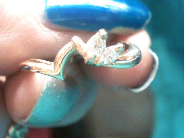 Lady's Gold-Diamond Ring Guard 4 Diamonds .12 Carat T.W. 10K Yellow Gold 1.4dwt