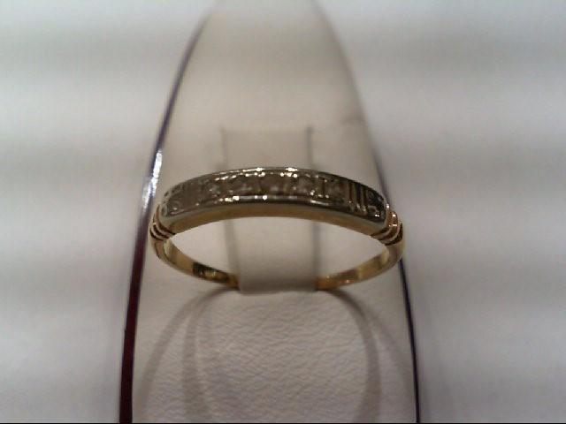 Lady's Diamond Wedding Band 5 Diamonds .05 Carat T.W. 14K Yellow Gold 1.9g