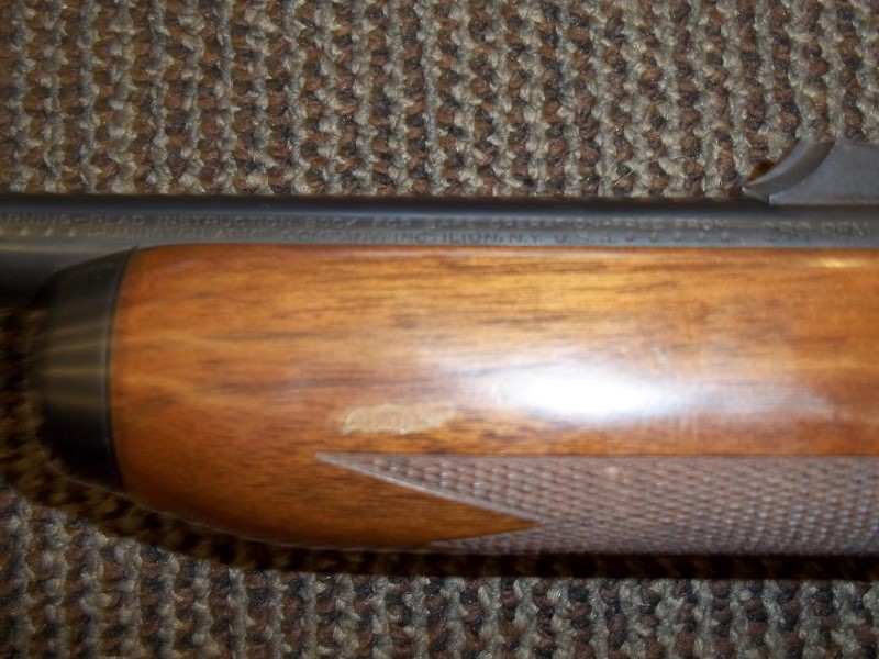 REMINGTON 7400 RIFLE .280 REM WOOD STOCK AND BLUED WITH SIMMONS 3.5-10x50 SCOPE
