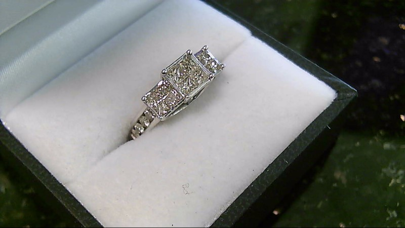 lady's 14k wht gold appx. 1.52cttw princess cut dia and round ring