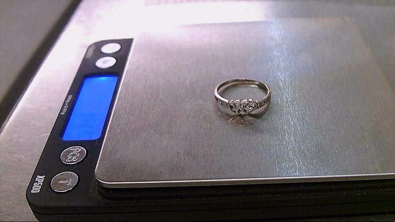 Lady's Diamond Fashion Ring 6 Diamonds .06 Carat T.W. 10K White Gold 1.41g
