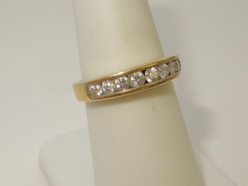 Lady's Diamond Fashion Ring 9 Diamonds .45 Carat T.W. 14K Yellow Gold 3.6g