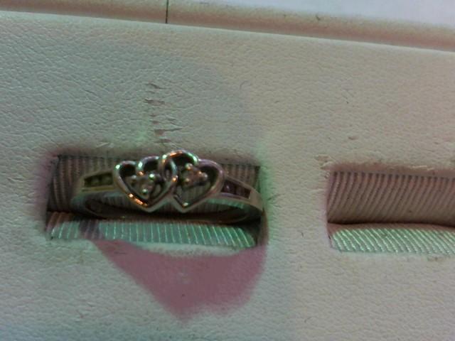Lady's Diamond Fashion Ring 6 Diamonds .08 Carat T.W. 10K White Gold 2.1g