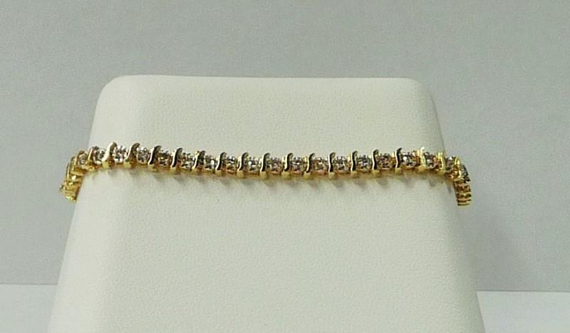 Gold-Diamond Bracelet 50 Diamonds 1.00 Carat T.W. 14K Yellow Gold 4.94dwt