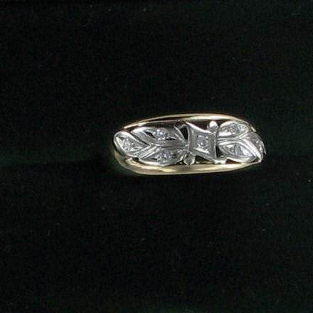 Lady's Diamond Fashion Ring 7 Diamonds .14 Carat T.W. 10K Yellow Gold 1.9dwt