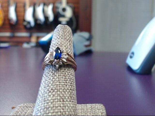 Sapphire Lady's Stone & Diamond Ring 8 Diamonds .14 Carat T.W. 10K Yellow Gold