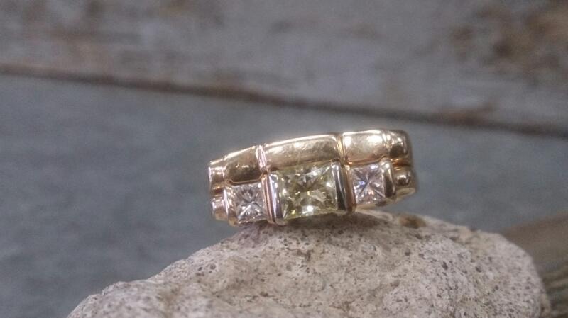 Lady's Diamond Fashion Ring 3 Diamonds .66 Carat T.W. 14K Yellow Gold 8.1g