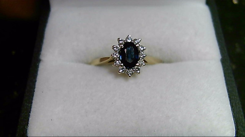 Lady's Oval Sapphire and Diamond 14K Yellow Gold Ring